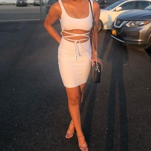 A white fashion nova dress with mid-area exposed.